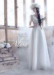 Robe de mariée Alisa neuve, ivoire, model Karen avec plumes - Occasion du Mariage