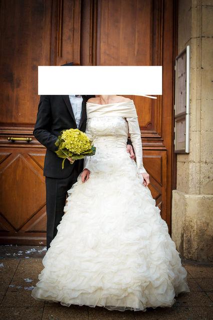 Robe de mariée bustier Pronuptia collection 2013 avec boléro en soie