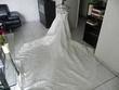 Robe de mariée à bretelles avec longue traîne