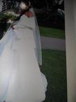 Robe de Mariée d'occasion de chez Point Mariage avec mitaine et chale ivoire