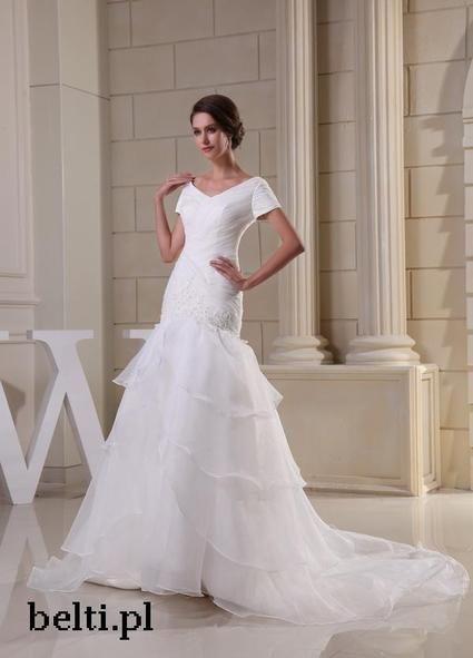 Une robe de mariée blanche neuve taille 38