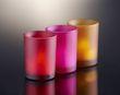 Bougeoirs en verre coloris fushia en décoration de table de mariage