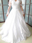 Robe de mariée neuve taille 34 avec cerceau et voile