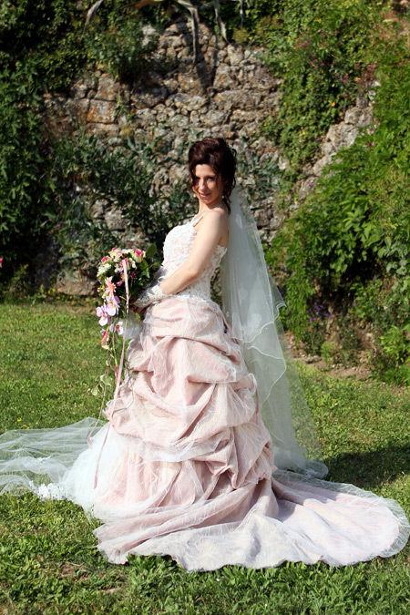 Robe de mariée de chez Princesse rose et ivoire d'occasion T38-40