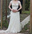 Magnifique robe de mariage ivoire en dentelle et satin - Occasion du Mariage