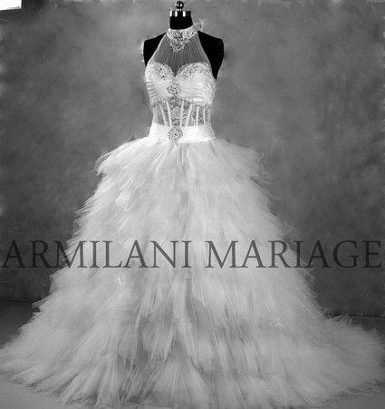 Robe de mariée bustier modèle unique en dentelle satin et perle