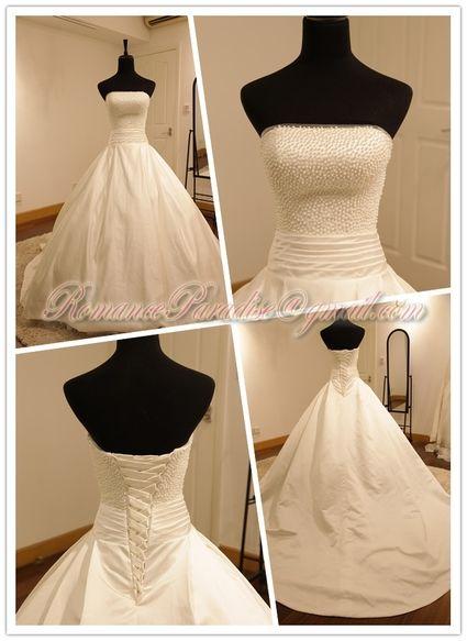 Robe de mariée non portée couleur ivoire faite sur mesure à Paris
