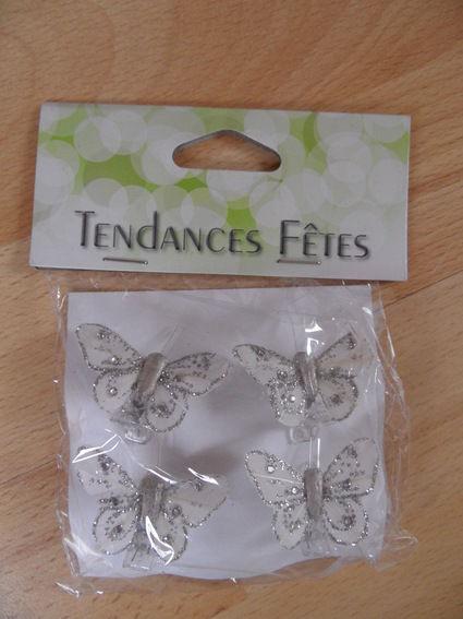 Pinces papillons argent en décoration de table de mariage