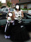 Robe de mariée noire et écrue d'occasion avec accessoires