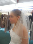 Robe de mariée ivoire / argent avec voile, guêpière, jupon, étole