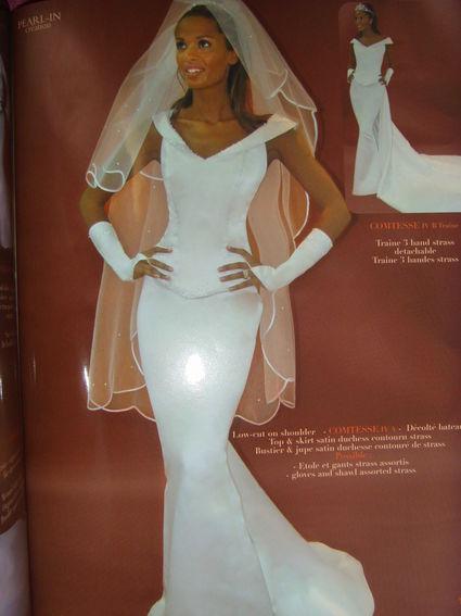 Robe de mariage neuve couleur ivoire et matière satin