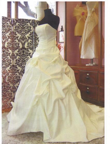 Robe de mariée bustier avec traîne d'occasion taille 42