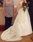 Magnifique robe de mariée ivoire à motifs rouge avec traine d'occasion