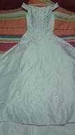 Robe de mariée ivoire effet bustier avec traine - Occasion du Mariage