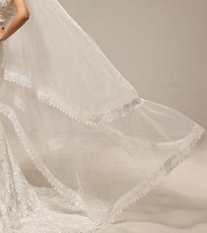 Superbe long voile neuf de mariée d'occasion en dentelle